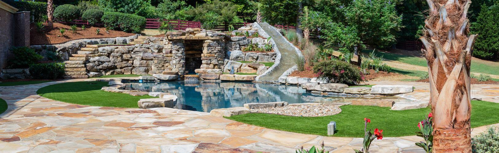 Beautiful pool and lawn landscaping job by Residential Landscaping Company Hicks Landscape in Raleigh